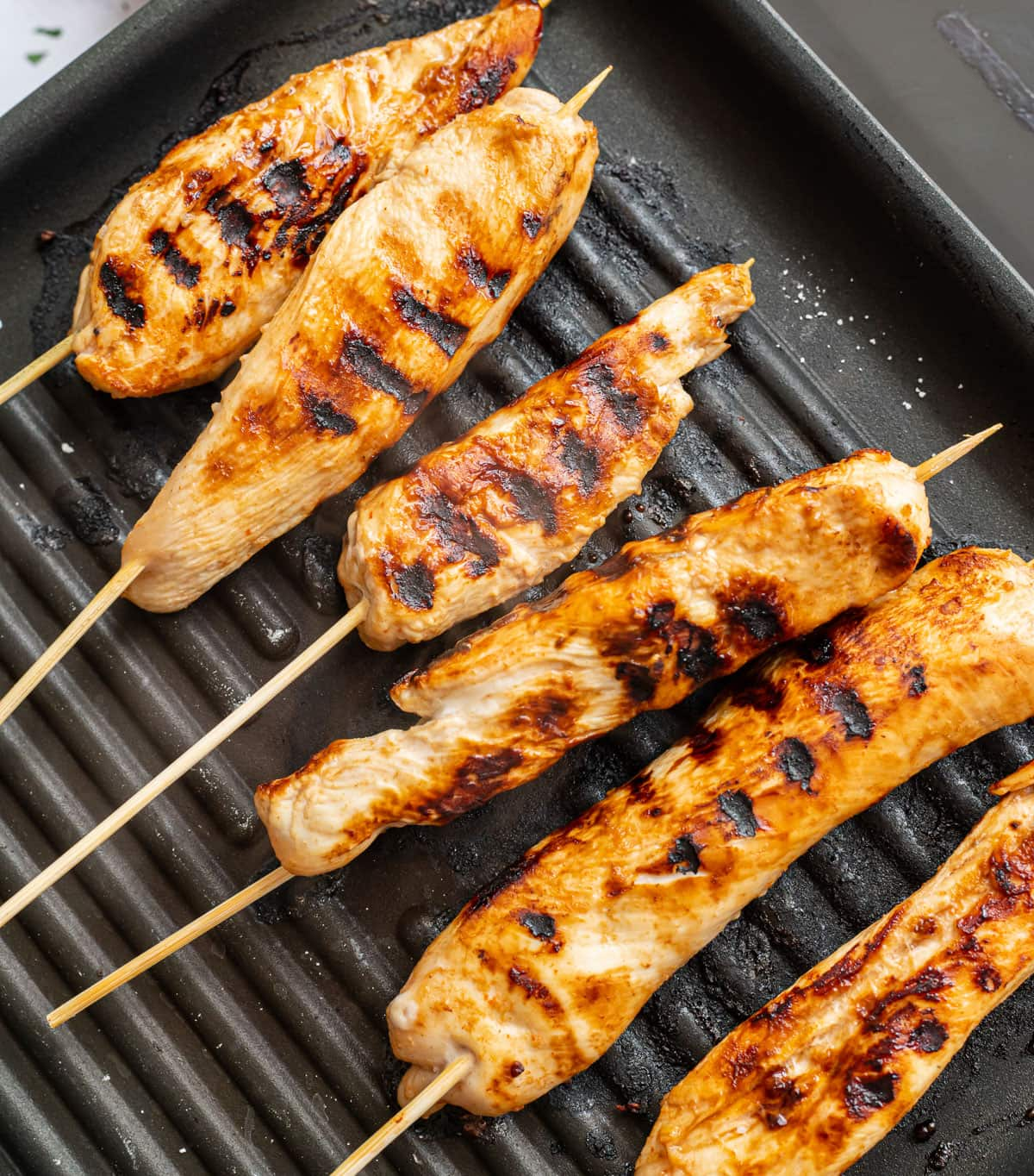 Chicken skewers being grilled