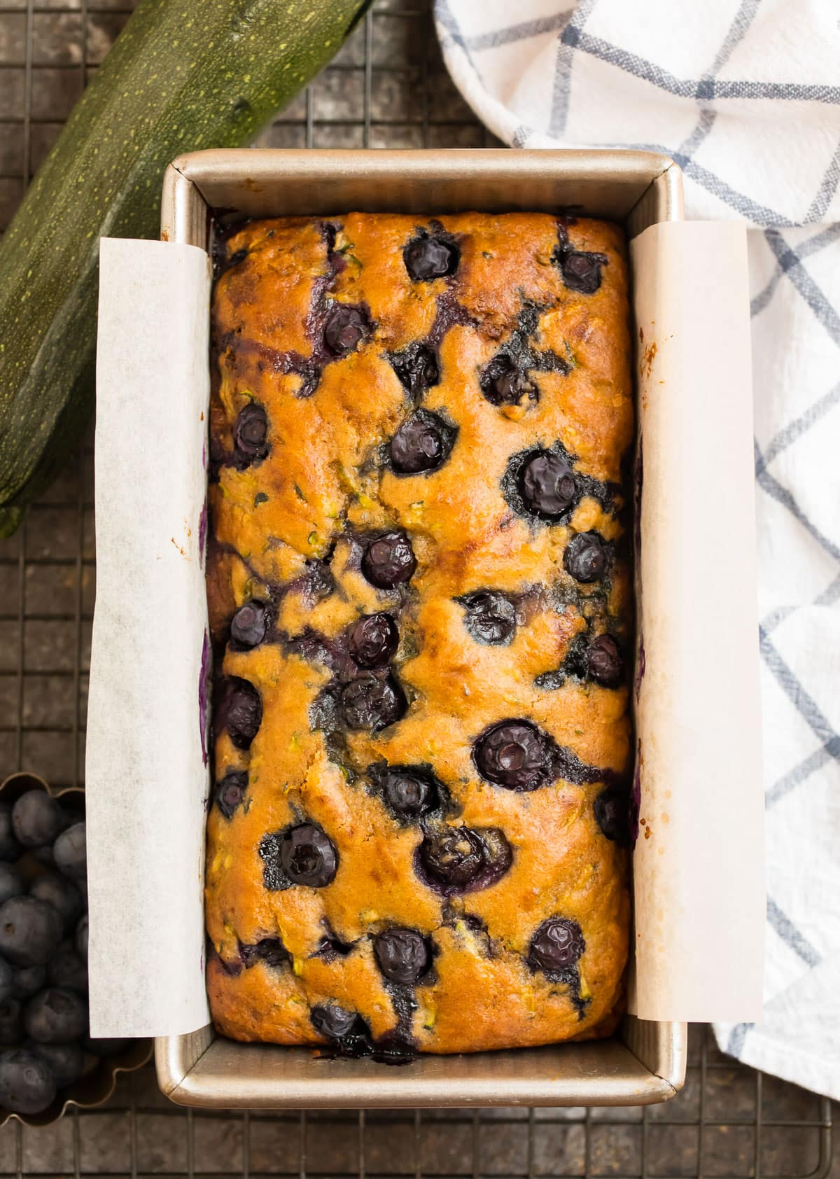 A loaf pan with blueberry zucchini bread