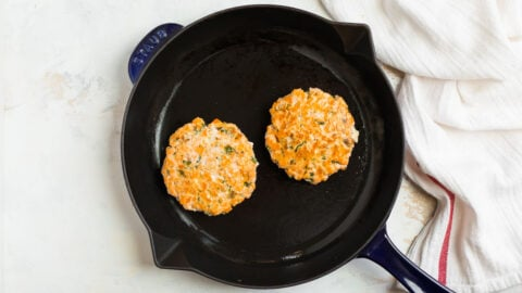 Salmon burgers in a skillet