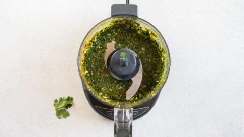 Garlic and cilantro in a food processor
