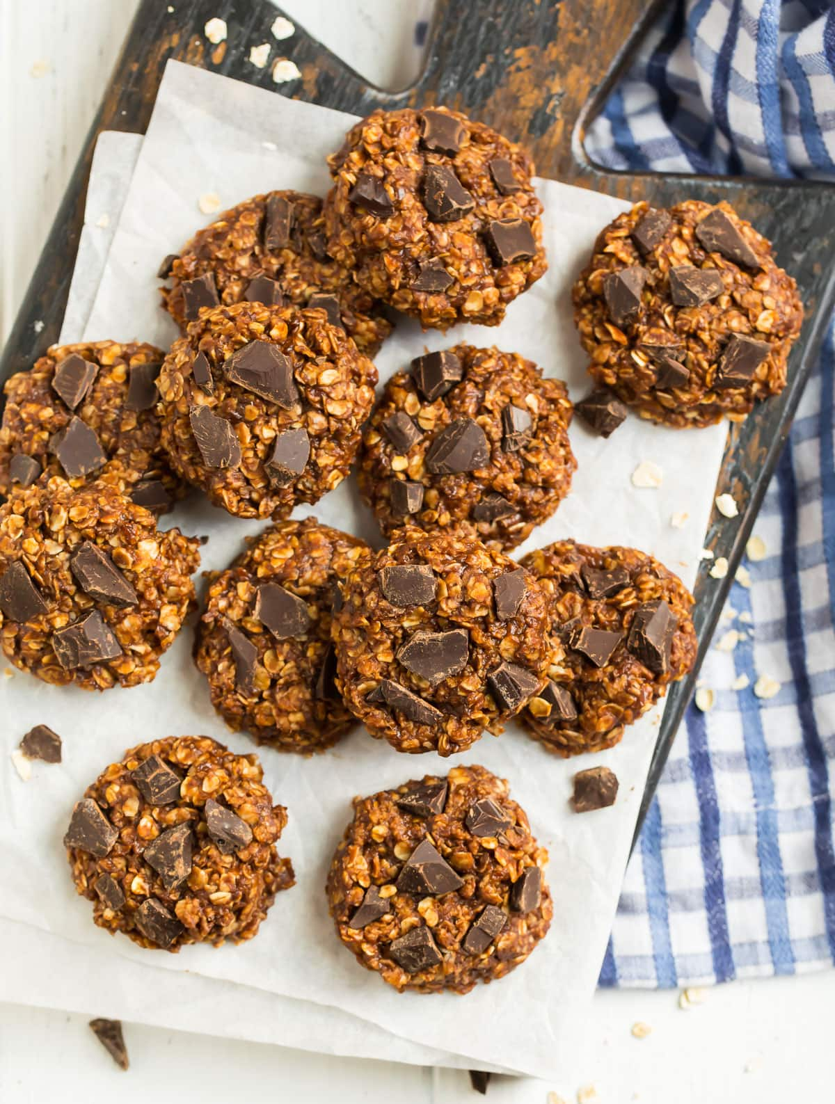 healthy no bake cookies on parchment paper topped with pieces of chocolate