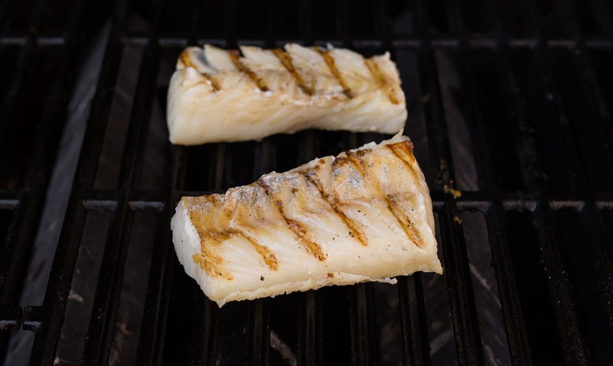 Two pieces of fish on a grill