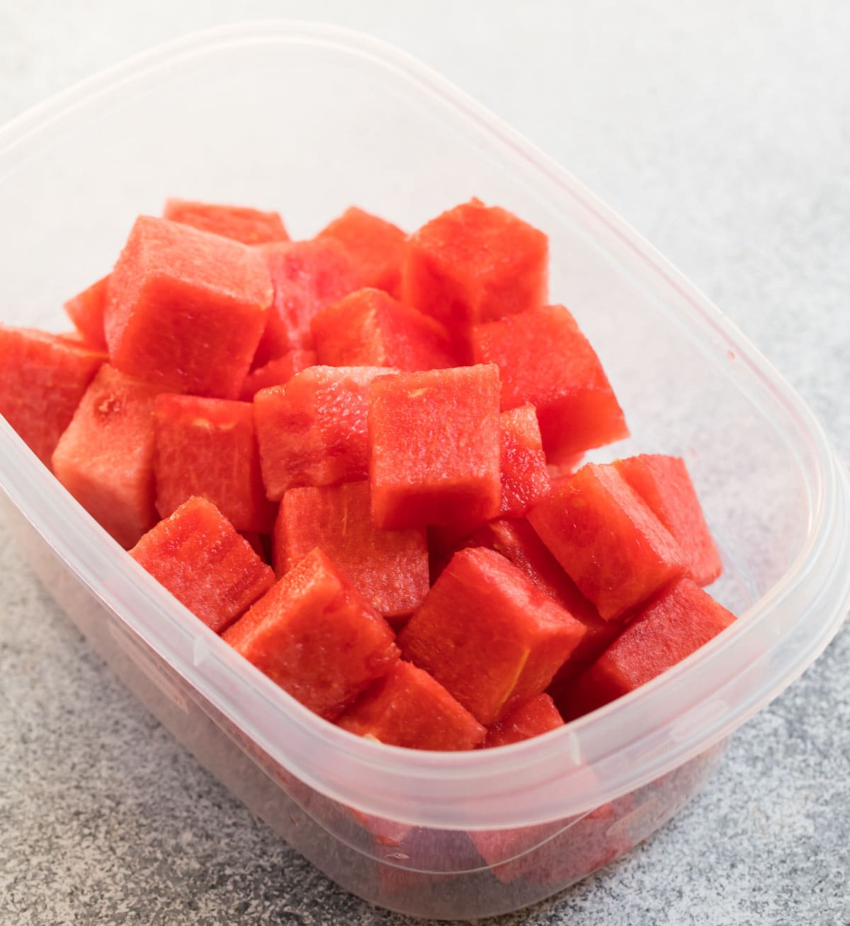 Cubes of watermelon in a container