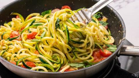 Vegetables and noodles in a skillet