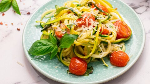 Zucchini pasta with tomatoes and basil on a plate