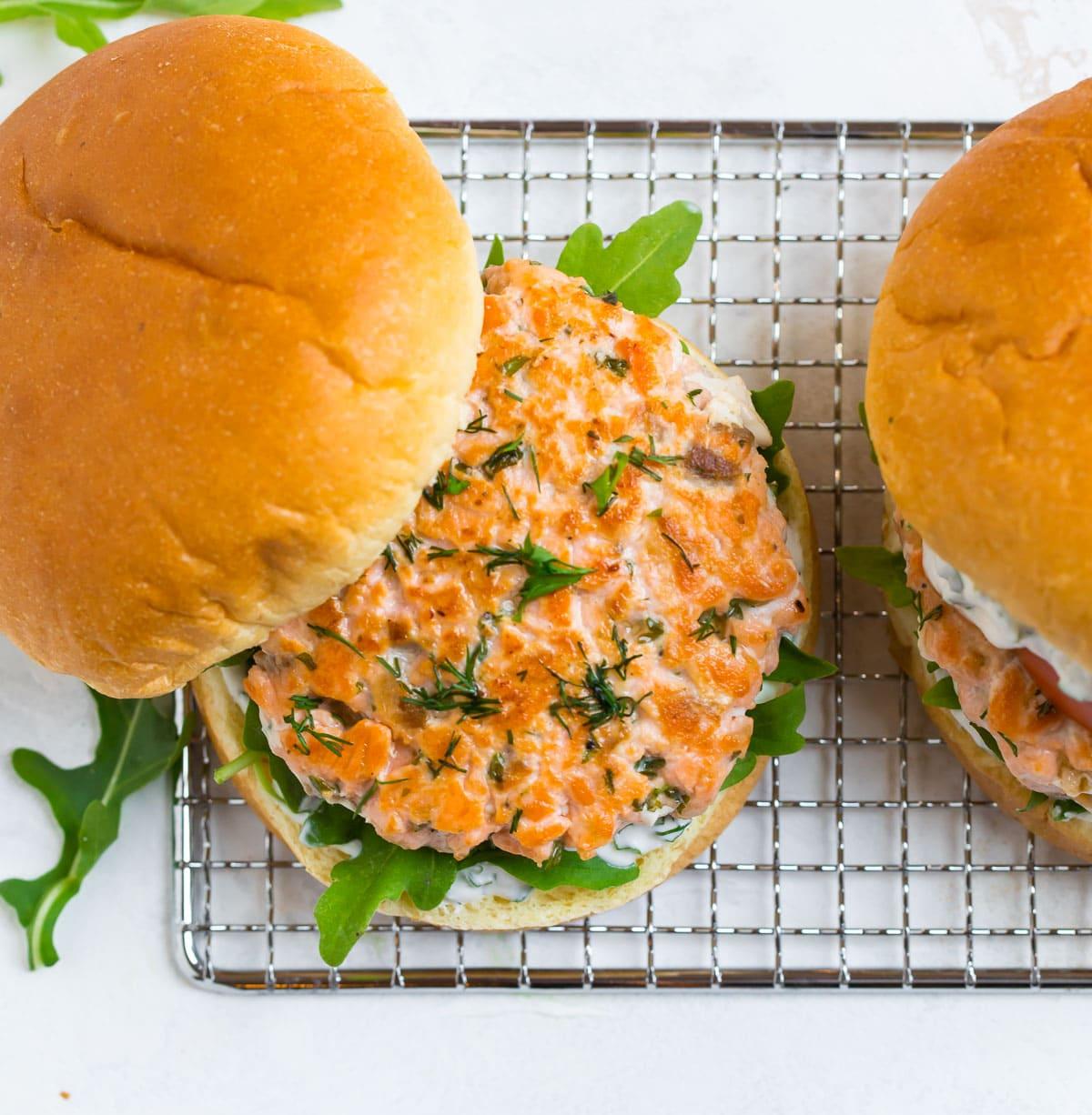 Salmon burger on a bun with arugula