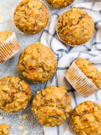 Zucchini carrot muffins on a kitchen towel
