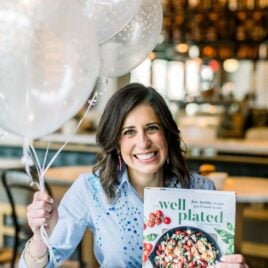 Erin Clarke with The Well Plated Cookbook and Balloons