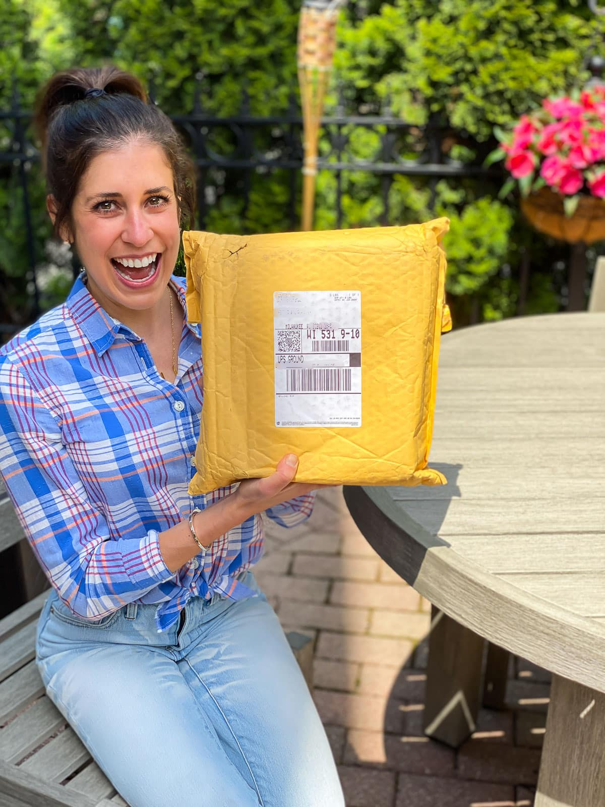 Erin Clarke holding package with cookbook