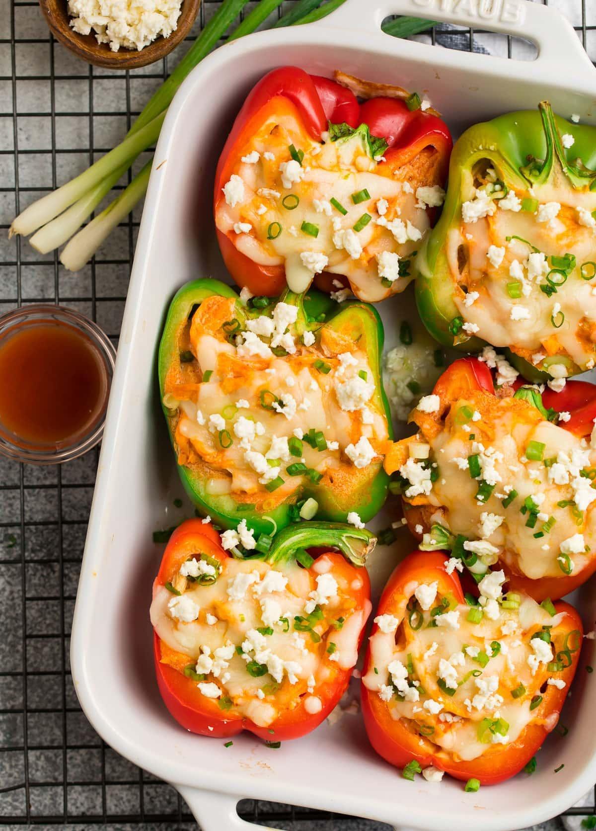 Easy buffalo chicken stuffed peppers in a baking dish