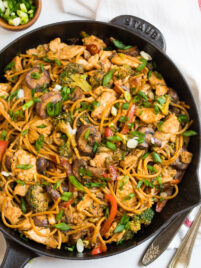 Chicken and noodle stir fry in a skillet
