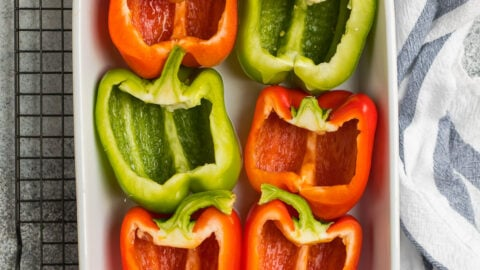 Halved bell peppers in a baking dish