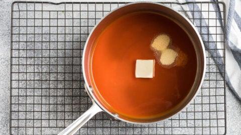 Orange sauce in a saucepan