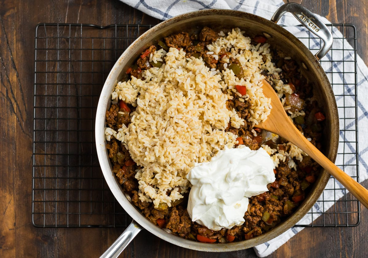 A pan with ingredients for Mexican casserole