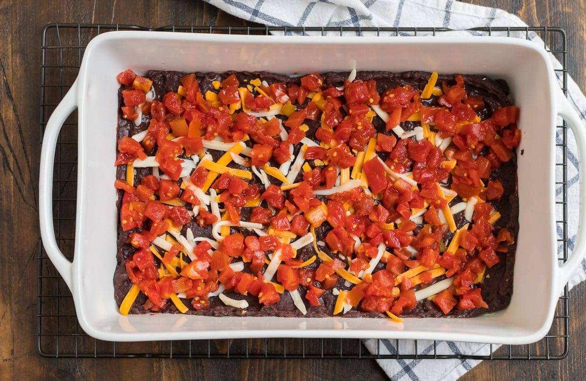Mexican casserole being prepared in a baking dish