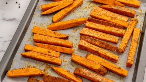 Healthy sweet potato fries on a baking sheet