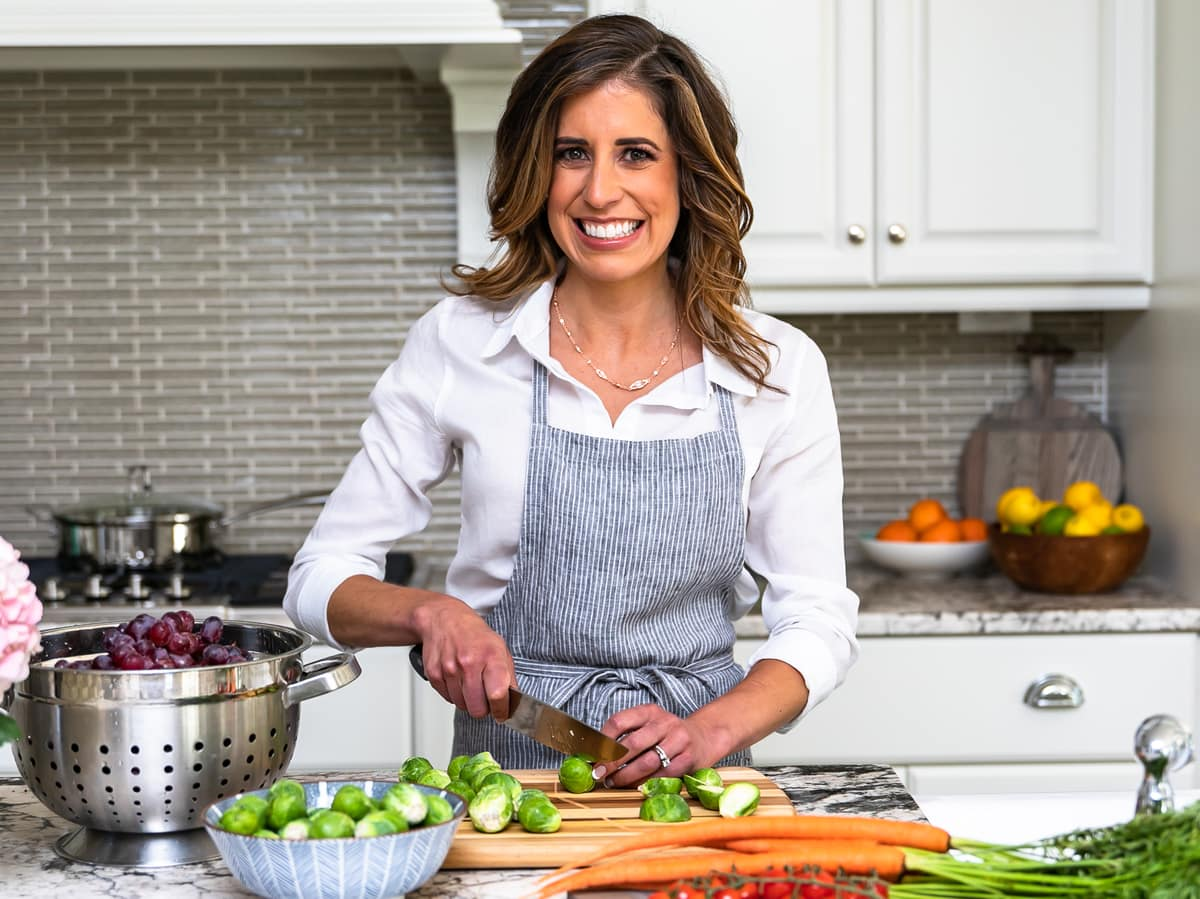 Erin Clarke chopping vegetables