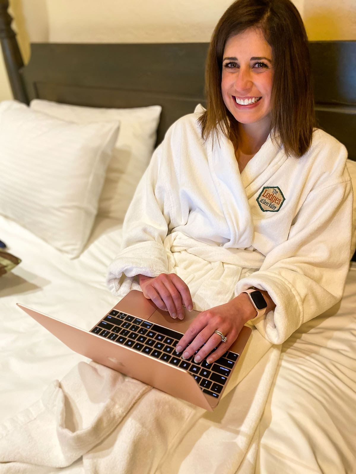 Working on a laptop in a bathrobe