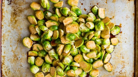 Chopped Brussels sprouts on a baking sheet
