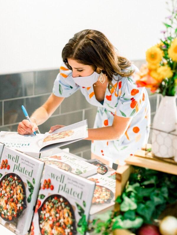 Erin Clarke autographing her cookbook