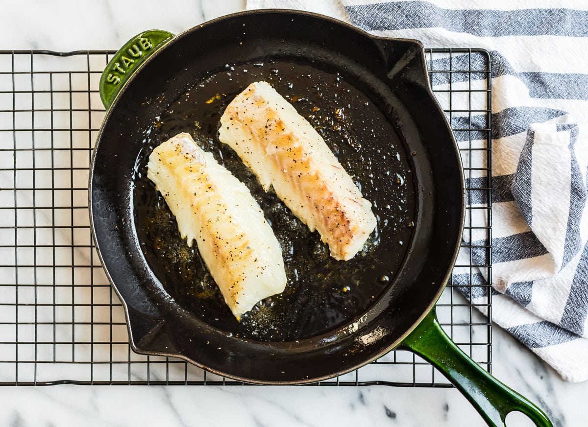 Two fish fillets in a skillet