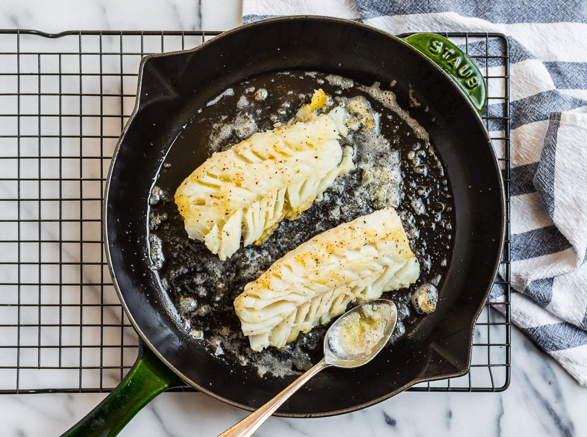 A skillet with cod fillets