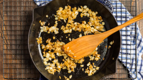 Onions being sauteed in a skillet