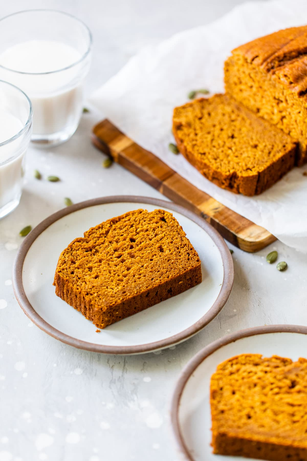 slices of healthy pumpkin bread on two white plates