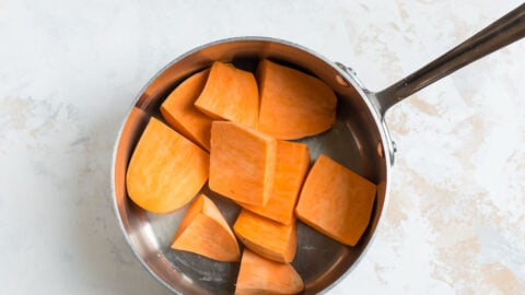 Sliced sweet potatoes in a saucepan