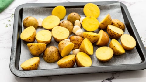 Chopped potatoes on a sheet pan