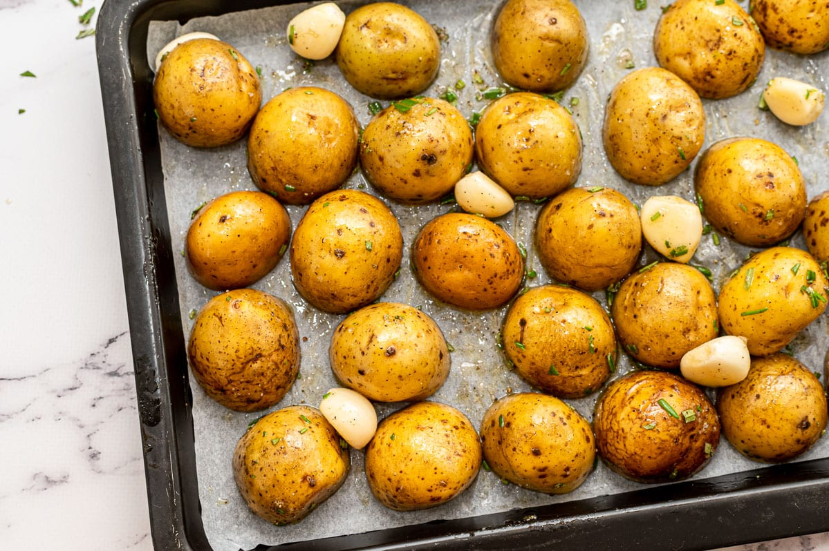 Potatoes and garlic on a sheet pan