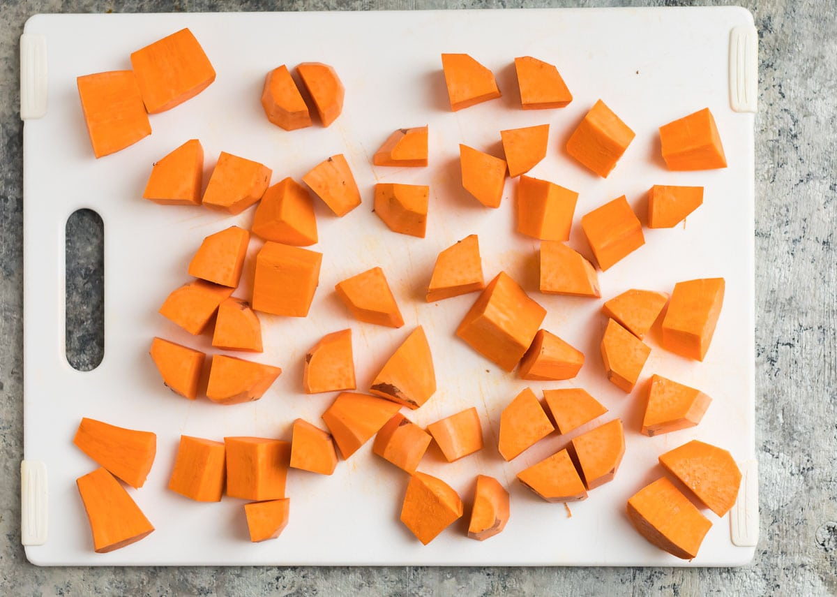 Chopped sweet potatoes on a cutting board