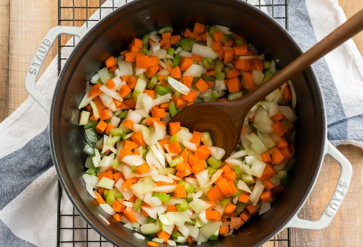 Diced vegetables in a Dutch oven