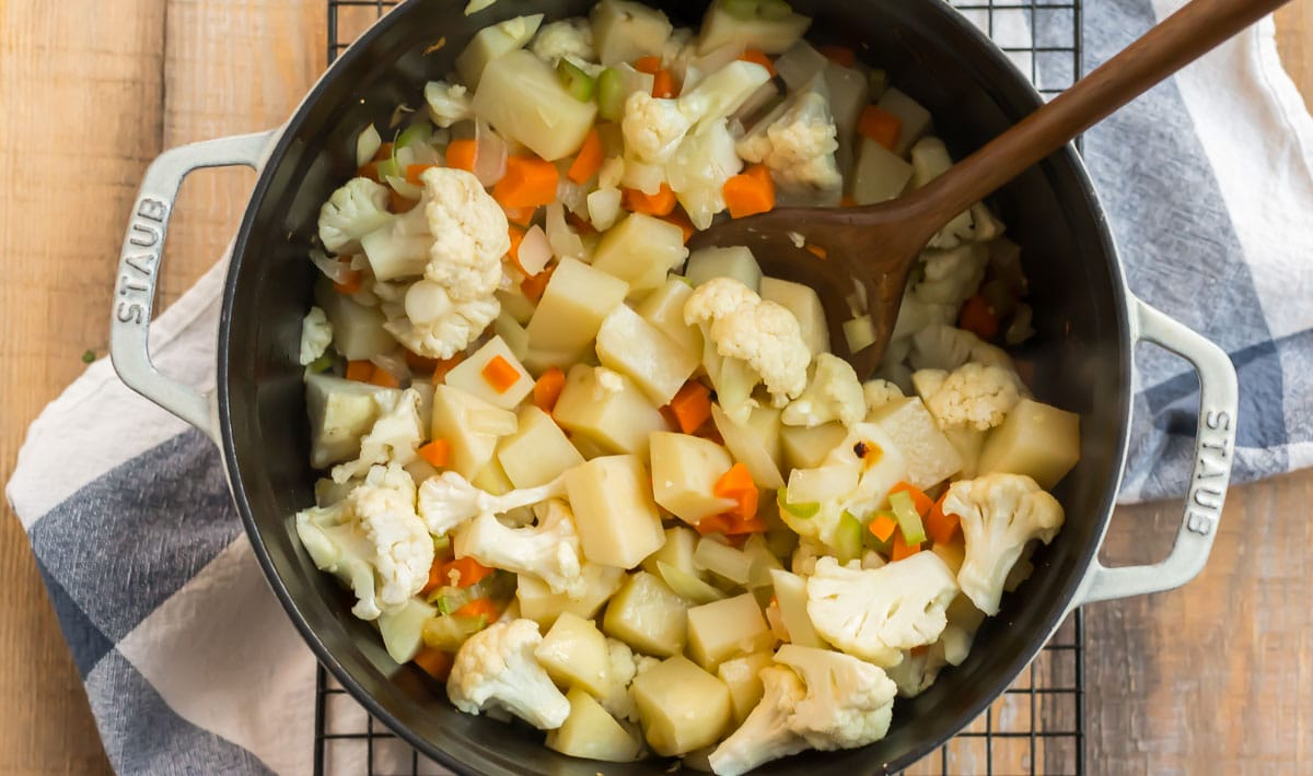 Vegetables being stirred in a pot