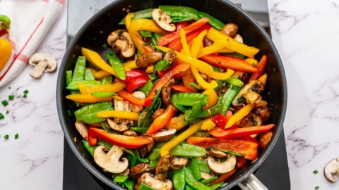 Veggies being sauteed in a skillet