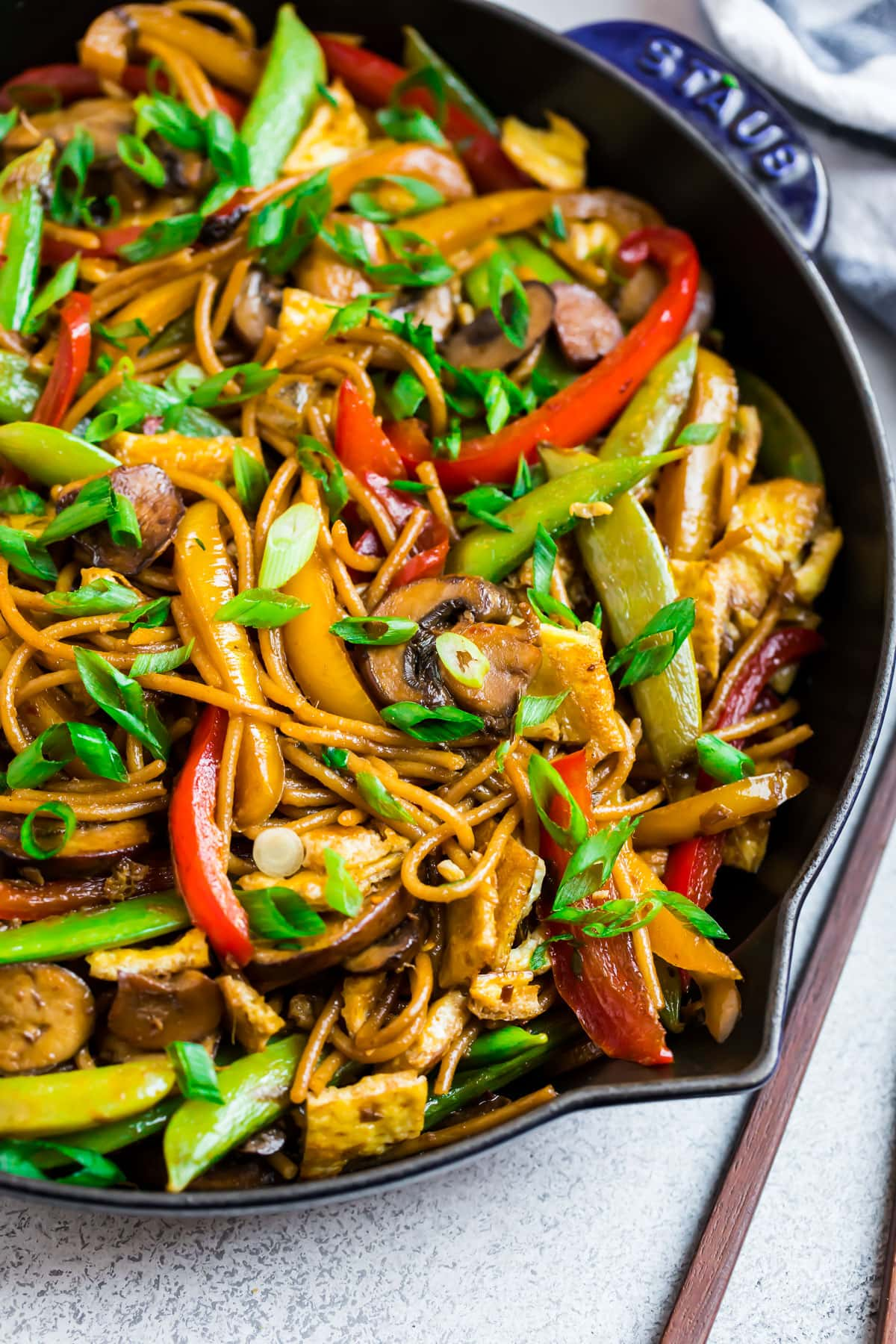 Vegetable lo mein in a skillet