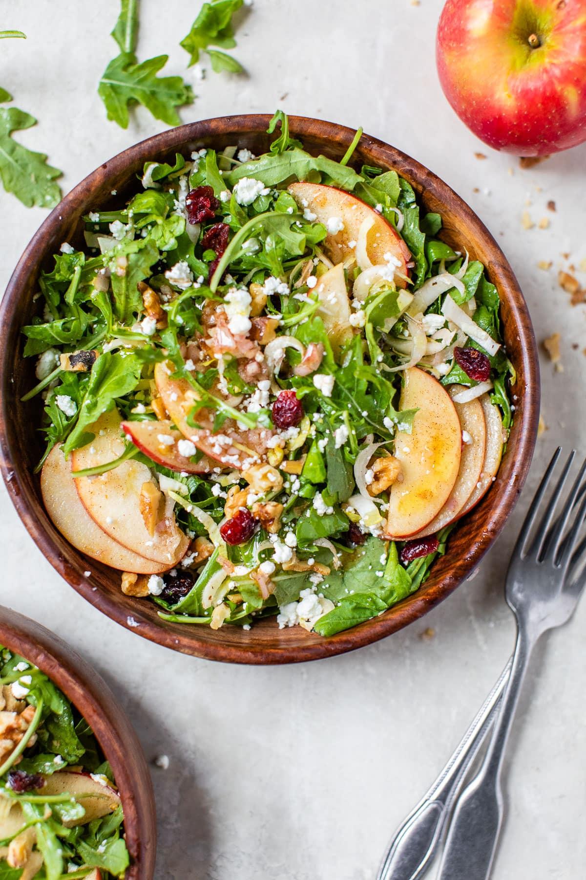 Healthy apple walnut salad in a bowl