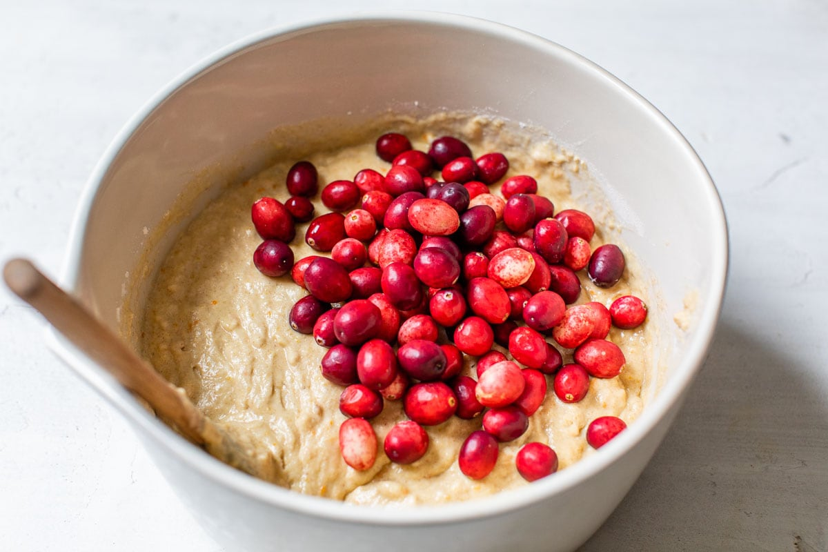 Cranberries in a bowl of batter