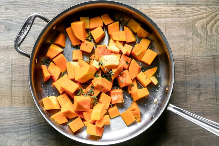 Chopped vegetables being cooked in a skillet
