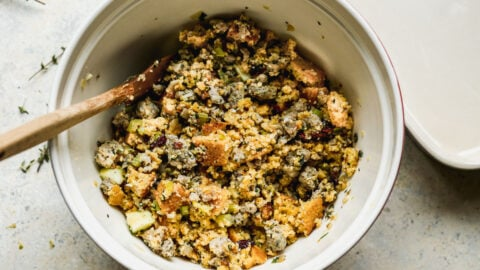 Stuffing ingredients being stirred in a bowl