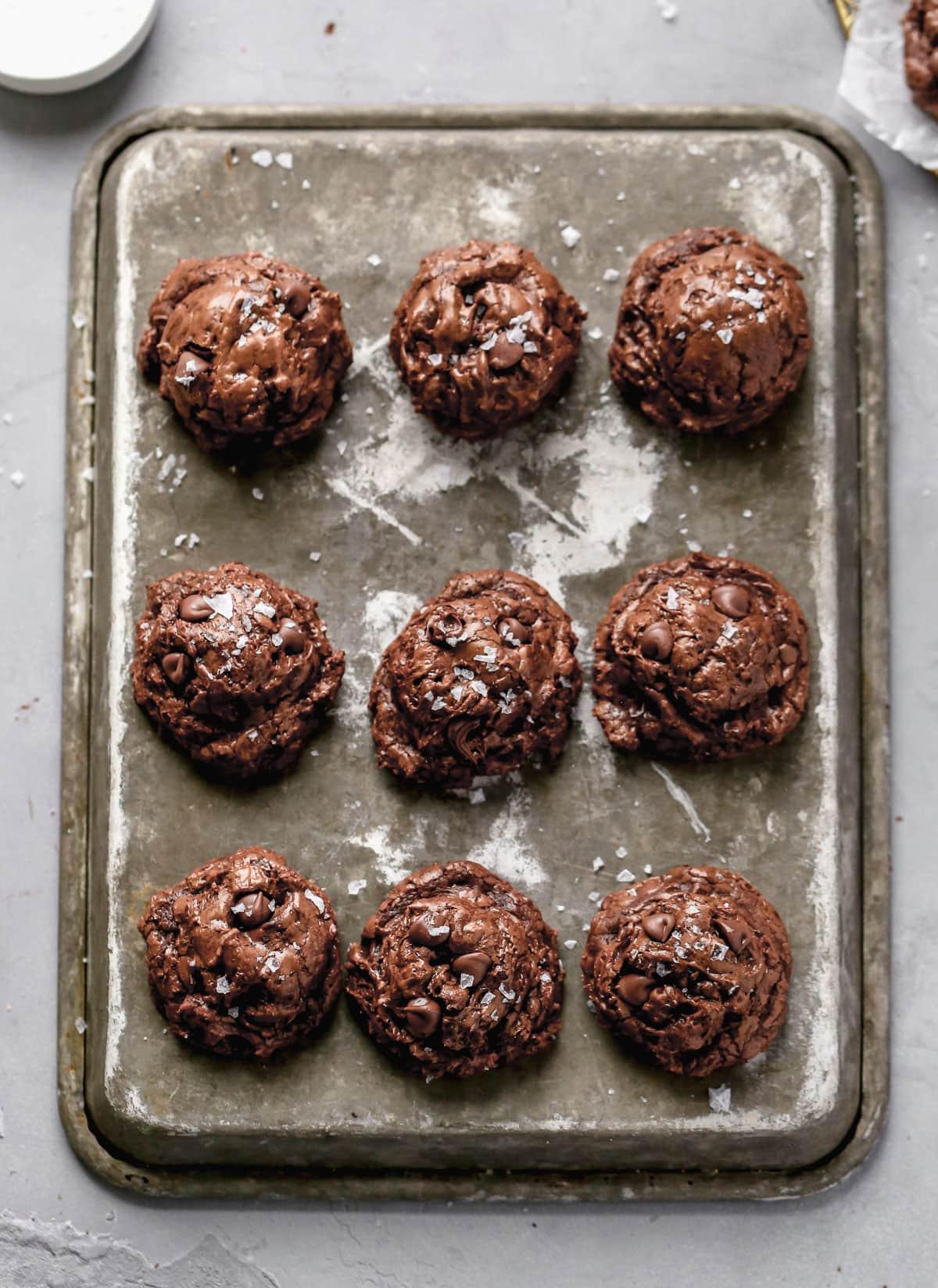 Dark chocolate cookies on a baking sheet