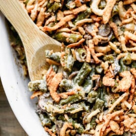 A baking dish of crockpot green bean casserole