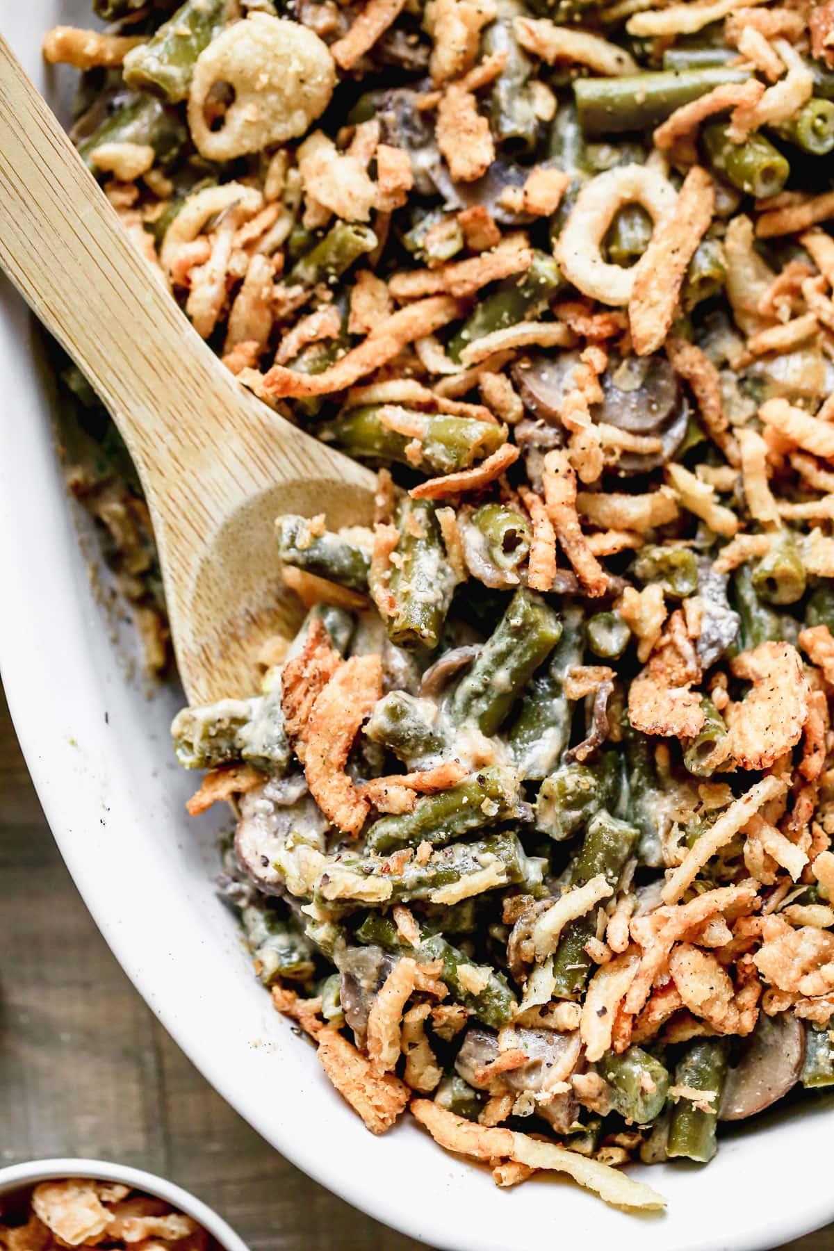 A baking dish of crockpot green bean casserole