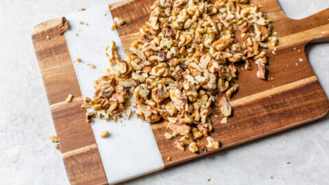 Chopped walnuts on a cutting board
