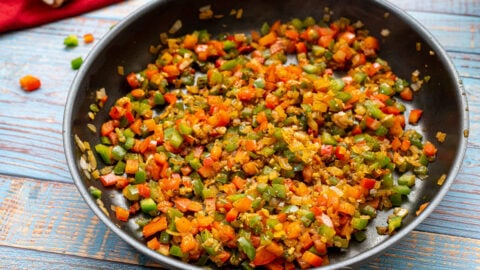 Chopped vegetables and spices in a skillet