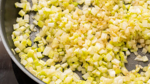 Onions and celery in a skillet