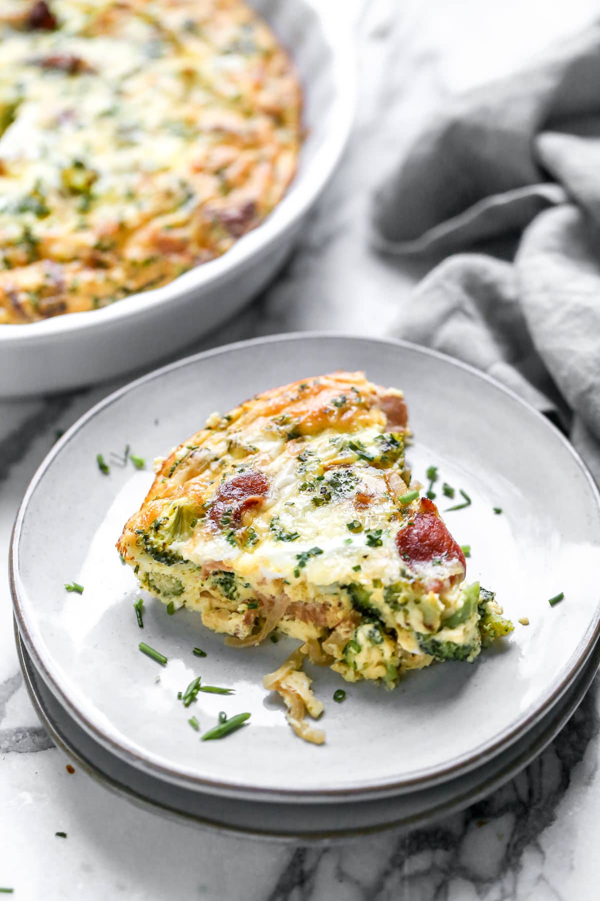 A slice of crustless quiche on a plate