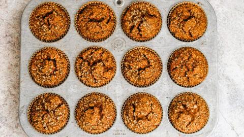 Pumpkin gingerbread muffins in a muffin pan