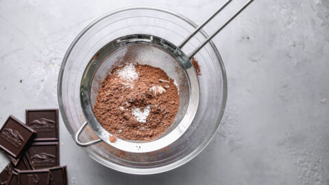 Chocolate and flour being sifted