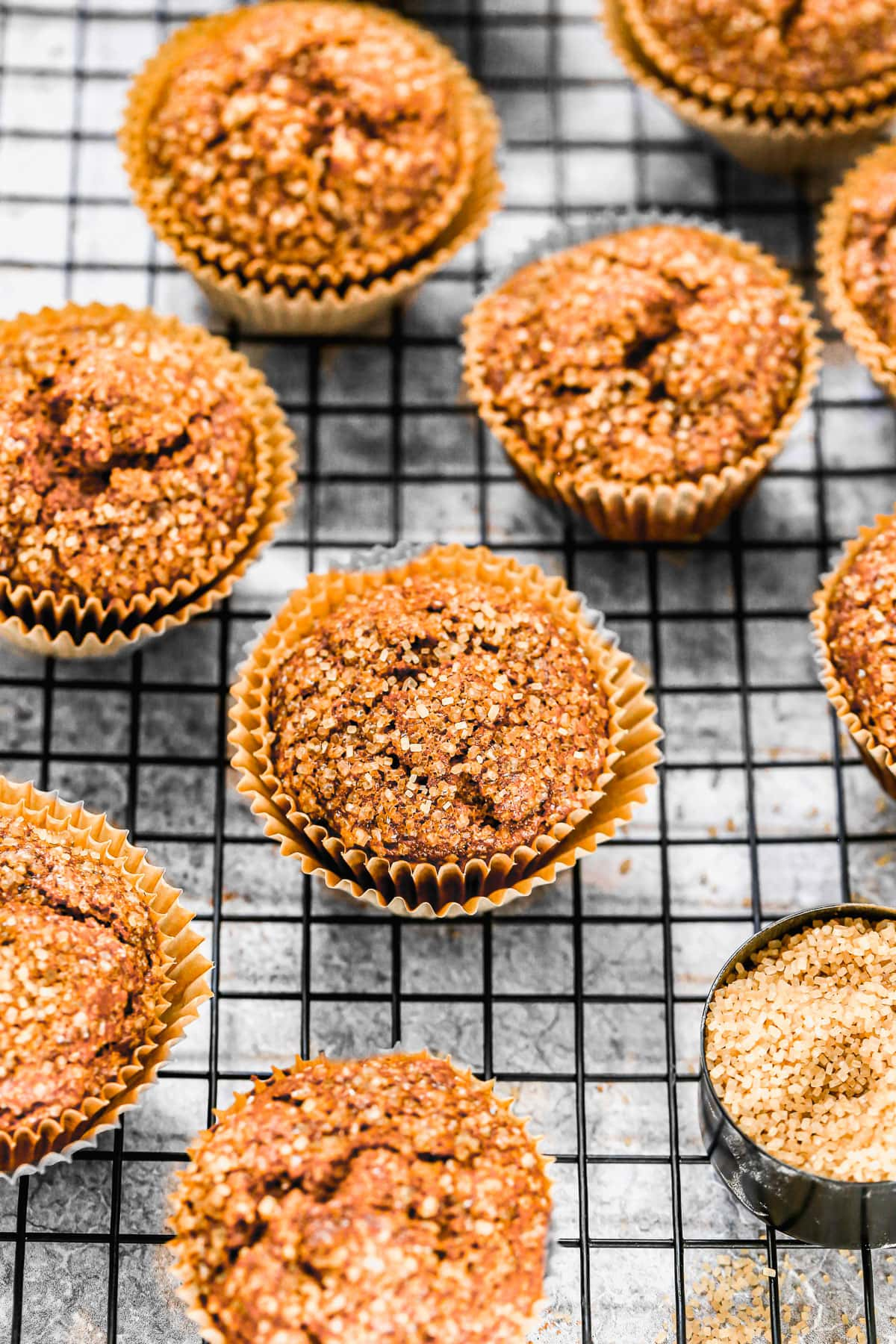 Fluffy pumpkin gingerbread muffins with sugar on top